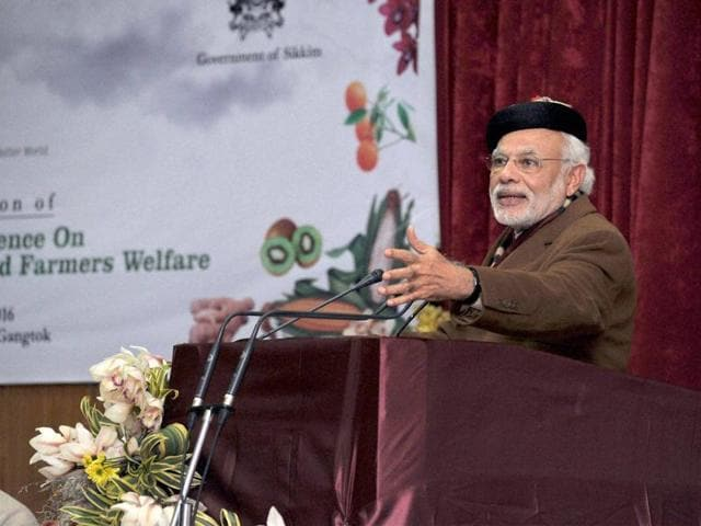Gangtok: Prime Minister Narendra Modi addresses the plenary session of National Conference on Sustainable Agriculture & Farmers Welfare, in Gangtok on Monday. PTI Photo (PTI1_18_2016_000276B)