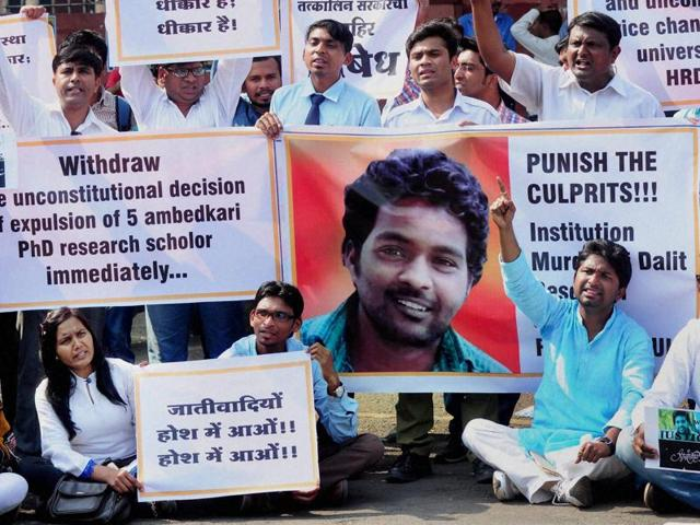 Police use water cannons to disperse students during a protest against the HRD ministry in New Delhi on Monday over the suicide of a PhD scholar Rohith Vemula at Hyderabad Central University.