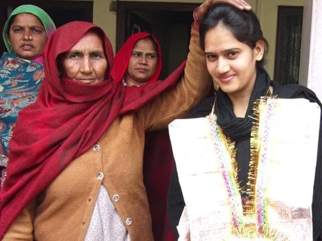 An elderly woman blessing Pooja, the new sarpanch of Shekhpura village of Hisar district , on Monday.