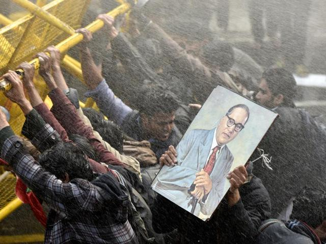Police use water canon to disperse members of various student organisations during a protest in front of HRD Ministry office at Shashtri Bhawan, demanding to sack the Vice Chancellor of Hyderabad Central University against the death of Rohith Vemula, a Dalit research fellow who committed suicide.