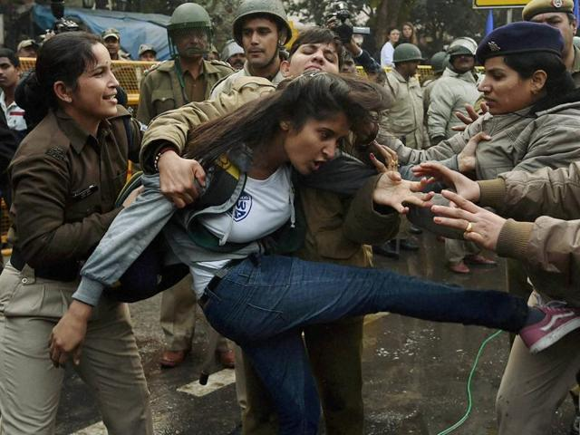 Police detain a student a protesting against the HRD Ministry in Delhi over the suicide of a PhD scholar Rohith Vemula.