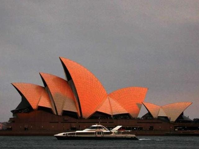 A ferry sails past the Sydney Opera House in Sydney, which was evacuated last week following a security threat by a teen on social media.
