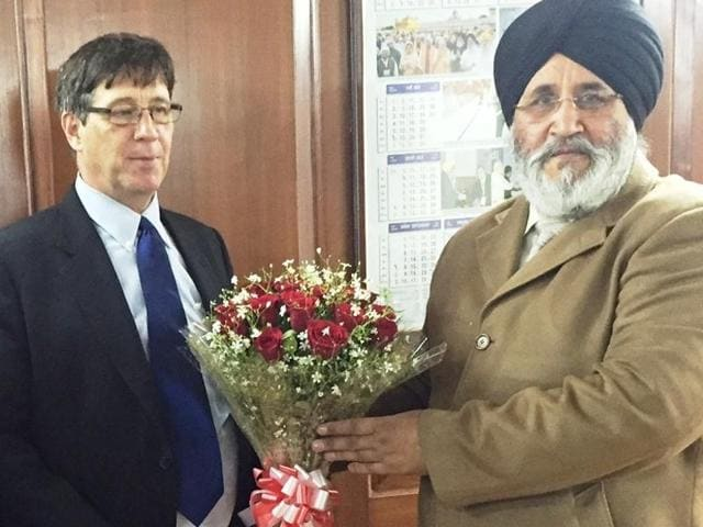 James Stone (left), the first secretary (political relations) of Canadian high commission, with Punjab education minister Dr Daljit Singh Cheema in Chandigarh on Tuesday.