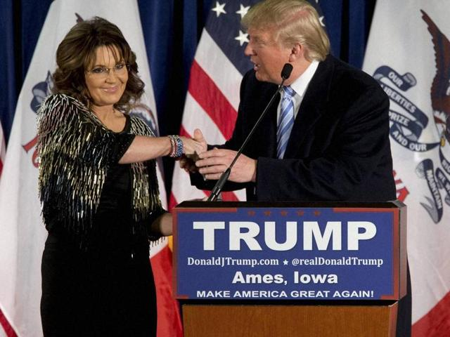 Former Alaska governor Sarah Palin (L) endorses Republican presidential candidate Donald Trump during a rally at the Iowa State University.