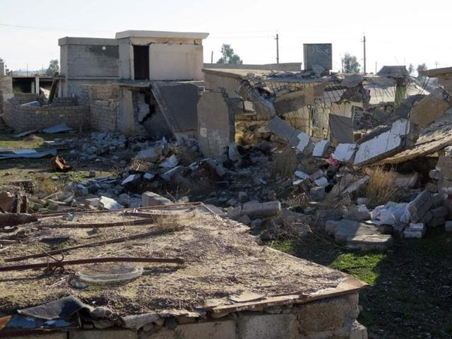 A handout picture released by Amnesty International on January 19, 2016 shows destroyed homes in the village of Barzanke in Iraq's northeastern Diyala province.