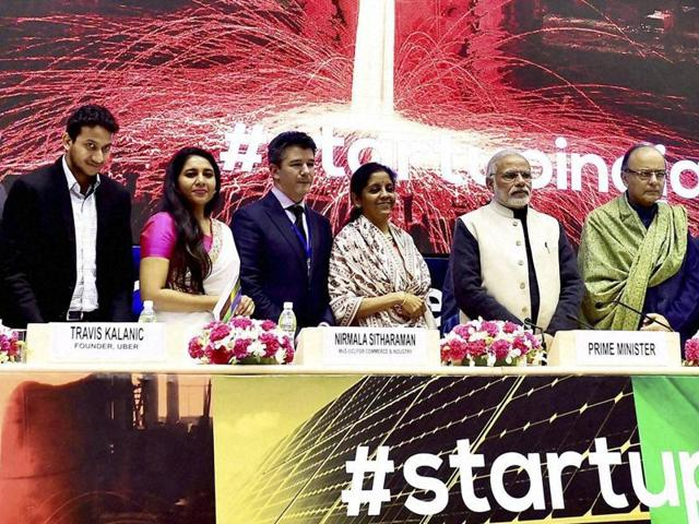 Prime Minister Narendra Modi poses for a selfie with the delegates during the launch of