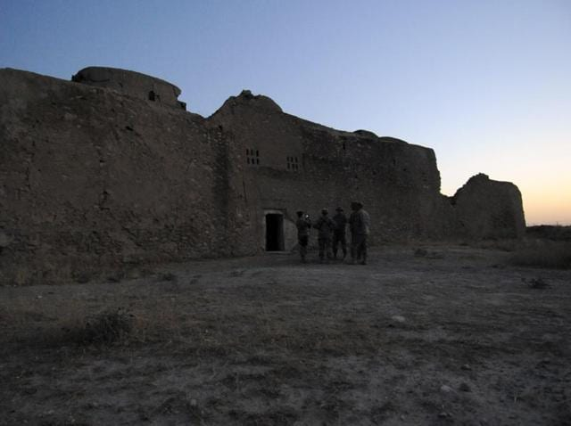 In this  file photo, released by the US Army, visitors stand at the entrance to the ruins of St Elijah's Monastery after completing a tour there, at Forward Operating Base Marez in Mosul, Iraq. The monastery has been reduced to a field of rubble, yet another victim of the Islamic State's relentless destruction.