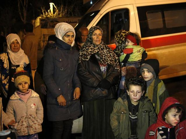 People wait to leave the besieged town of Madaya, northwest of Damascus, Syria. In the besieged eastern city of Deir el-Zour, supplies are running so short that people are selling their gold and other property for food or an exit permit allowing them to escape both the government and Islamic State militants who rule the region of Syria.