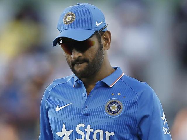 India's MS Dhoni walks back to his wicket keeping position during their one day international cricket match against Australia in Perth on January 12, 2016.