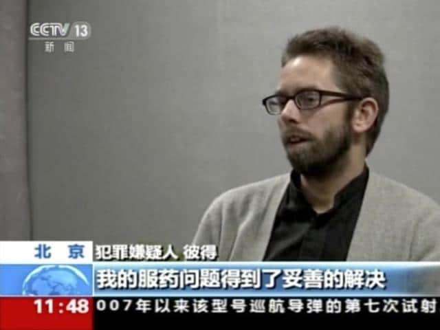 In this image made from undated video released by China Central Television (CCTV), Peter Dahlin, a Swedish co-founder of a human rights group, speaks on camera in an unknown location.