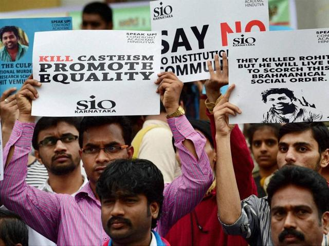 Members of the Students Christian Movement of India and other activists stage a protest in Bangalore following the suicide of Rohit Vemula, a doctarate student at the Hyderabad Central University, on January 19, 2016