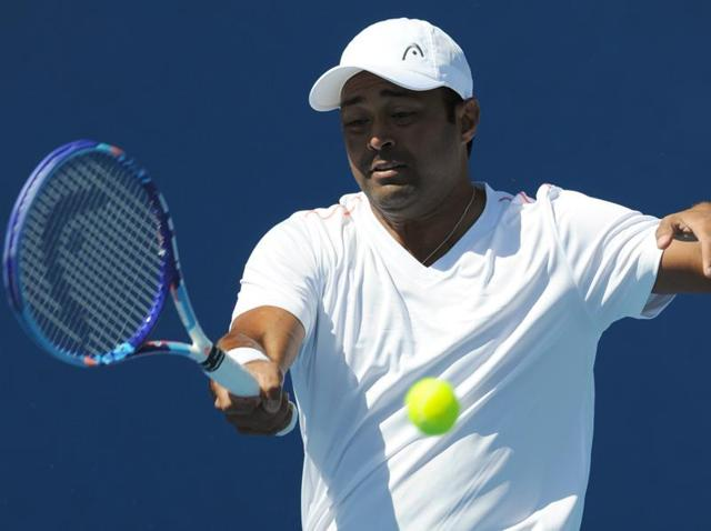 Leander Paes plays a forehand return during a practice session ahead of the 2016 Australian Open.