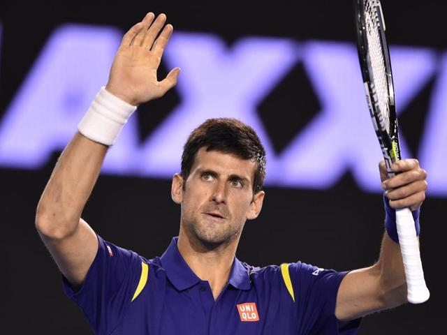 Serbia's Novak Djokovic celebrates after victory in his men's singles match against France's Quentin Halys on day three of the 2016 Australian Open in Melbourne on January 20, 2016.