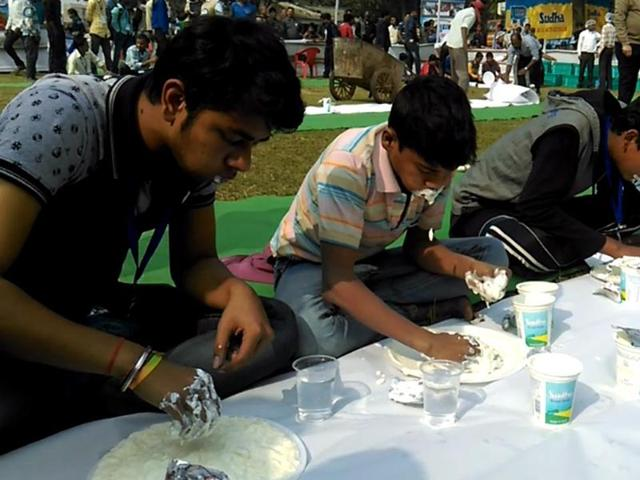 Participants lap it up at the Patna Dairy Project's curd-eating contest.