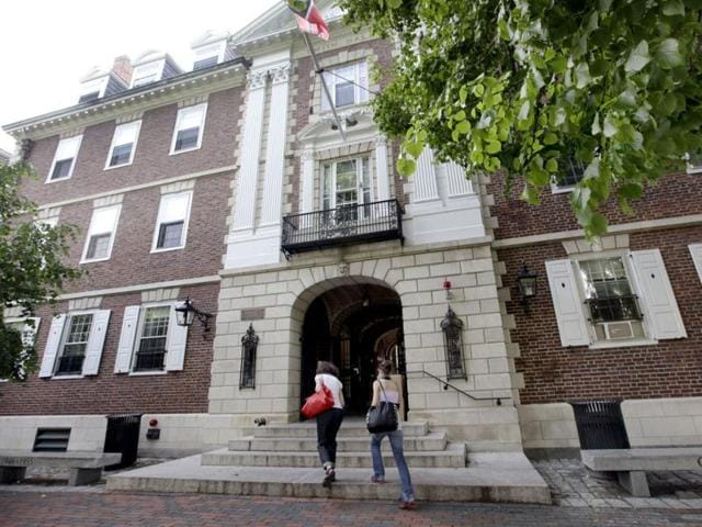 Students walk into Kirkland House on the campus of Harvard University in Cambridge.