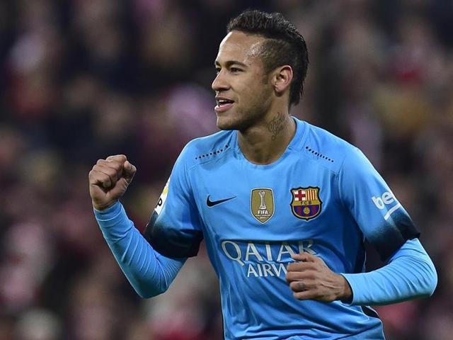 FC Barcelona's Neymar celebrates his goal with Munir El Haddadi during their Spanish Copa del Rey quarterfinal match, first leg, against Athletic Bilbao at San Mames stadium in Bilbao on January 20 2016.