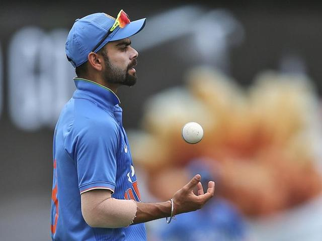 Virat Kohli plays a shot during the third one-day international in Melbourne.