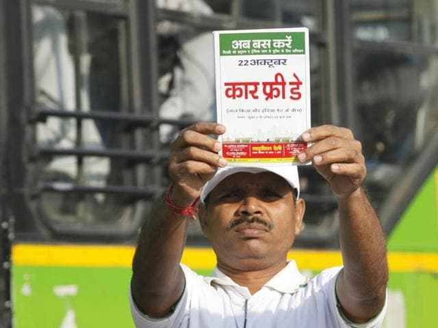 File photo of a civil defence volunteer holding a placard during a cycle rally on Car Free Day in New Delhi.