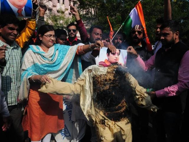 Congress workers in Bhopal burn an effigy of HRD minister Smriti Irani to protest her comments on Rohith Vemula. Irani had said Vemula's death was not related to caste.