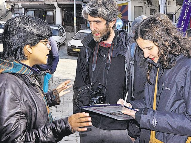 An activist of the Students for Free Tibet getting signature of a foreigner during a campaign in Dharamshala on Thursday.