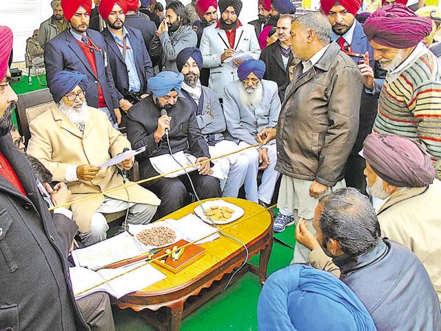 Chief minister Parkash Singh Badal listening the grievances at Shaheed Bhagat Singh Nagar on Friday.