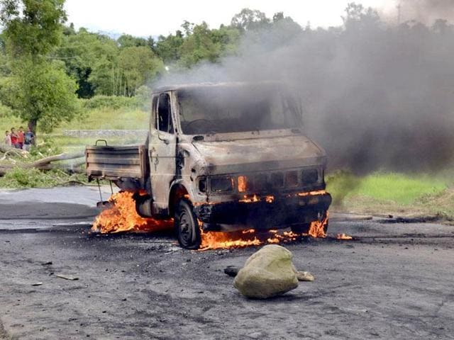 A vehicle is set on fire during a protest in Manipur on September 1, 2015.