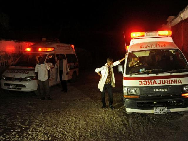 Two ambulances stand on the scene of a bomb attack on at Lido Beach, in Mogadishu.