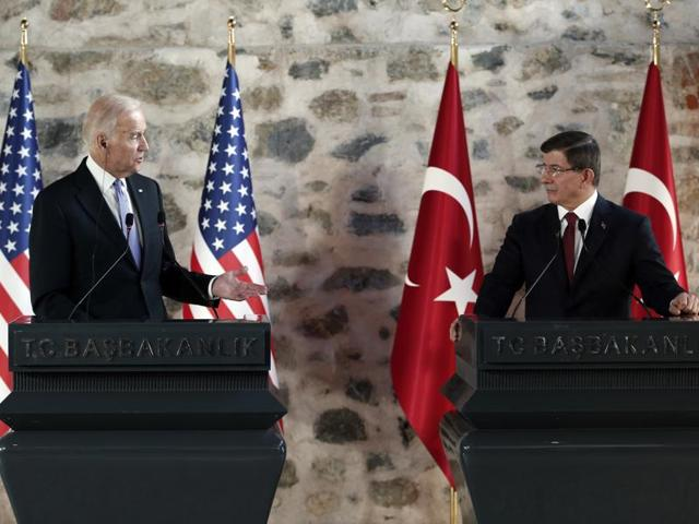 US vice-president Joe Biden talks as Turkish Prime Minister Ahmet Davutoglu looks on during a joint news conference following their meeting in Dolmabahce Palace in Istanbul.