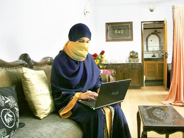 A lady in Moradabad, Uttar Pradesh. Muslim women straddle both tradition and modernity.