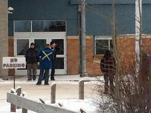 The outside of La Loche Community School is shown on Friday Jan. 22, 2016. Prime Minister Justin Trudeau said the shootings occurred at a high school and another location but did not say where else.(AP)