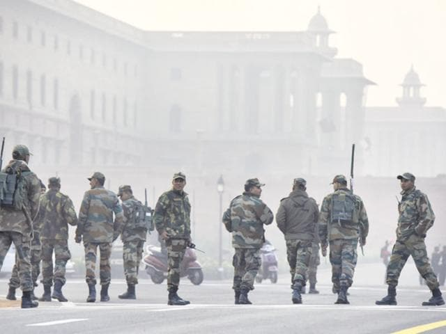 Army troops stand guard outside Rashtrapati Bhavan after Republic Day rehearsals on Friday.