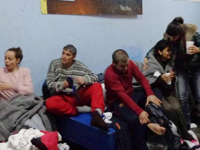 Survivors change clothes at Kalymnos island after a rescue operation by the coast guard on Friday.