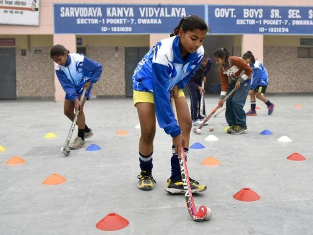 Students of Sarvodaya Kanya Vidyalaya, members of the Delhi U-14 girls hockey team, practice on a concrete platform in their school premises at Mahavir Enclave in Dwarka, New Delhi, on January 22, 2016.