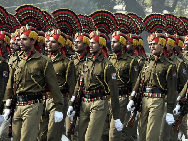 Indian Army soldiers march past during rehearsals for the upcoming Republic Day Parade 2016 at Rajpath in New Delhi on Monday.