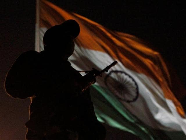A commando on security vigil at the Rajpath during rehearsal for Republic Day parade in New Delhi.