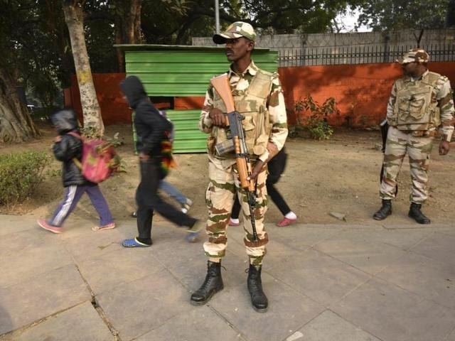 Delhi Police personnel stand guard in front of a shopping mall in view of high security alert in New Delhi.