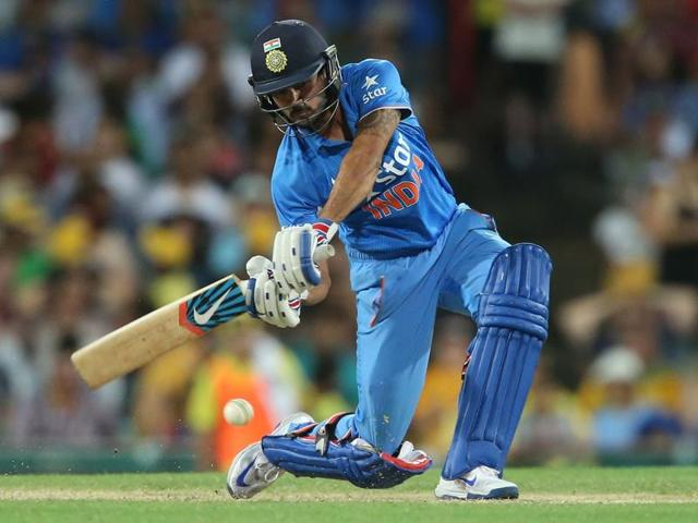 Manish Pandey kisses his helmet after hitting a century during their ODI match against Australia in Sydney.
