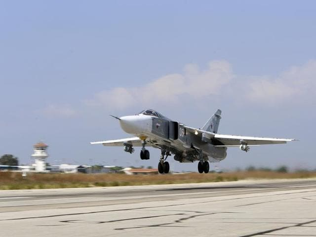 In this file photo, a Russian SU-24M jet fighter armed with laser guided bombs takes off from a runaway at Hmeimim airbase in Syria.
