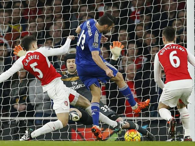 Diego Costa scores the first goal for Chelsea against Arsenal.
