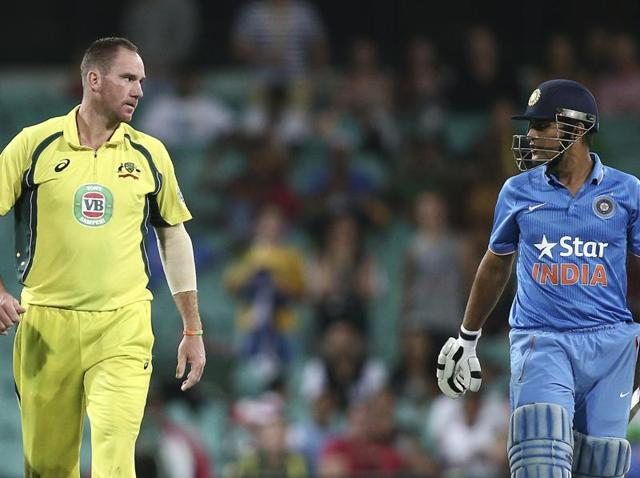 Australia's John Hastings, left, stares at India's MS Dhoni after an unsuccessful appeal for his wicket during their One Day International cricket match in Sydney on January 23, 2016.