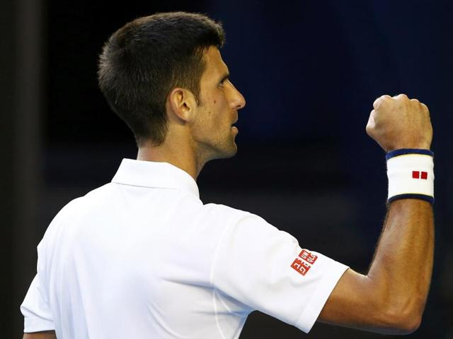 Novak Djokovic, right, of Serbia shakes hands with Gilles Simon of France after winning their fourth round match at the Australian Open in Melbourne on January 24, 2016.