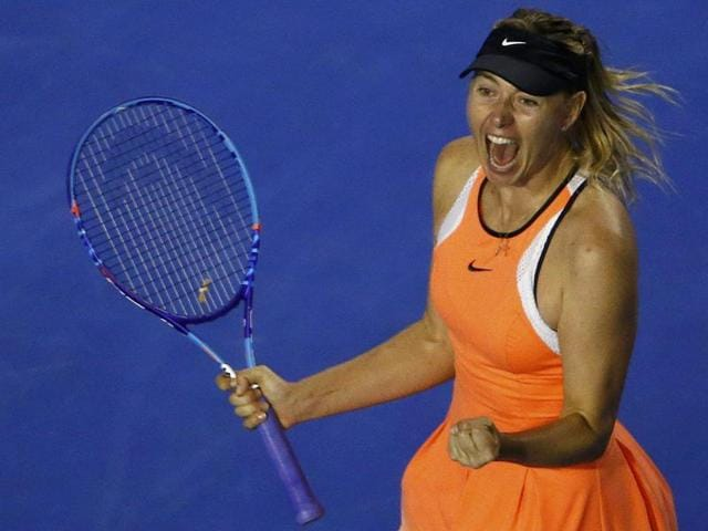 Switzerland's Belinda Bencic throws her racquet in frustration during her women's singles match against Russia's Maria Sharapova on day seven of the 2016 Australian Open in Melbourne on January 24, 2016.