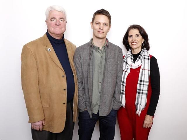 Director Brian Oakes, center, poses with John Foley, left, and Diane Foley, the parents of Journalist James Foley, for a portrait to promote the film, Jim at the Sundance Film Festival.