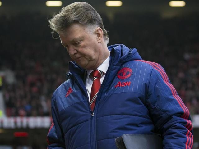 Manchester United's manager Louis van Gaal walks from the pitch after his team's 1-0 loss against Southampton.