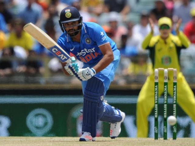 India's Rohit Sharma raises his bat after reaching 150 runs during the ODIagainst Australia in Perth.