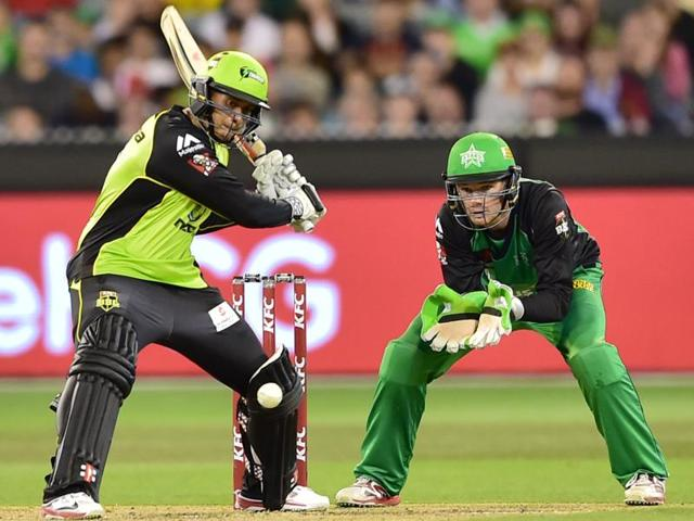 Sydney Thunder players gather to celebrate taking the wicket of Marcus Stoinis of the Melbourne Stars.