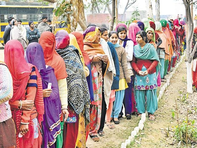 The third phase of the PRI polls were conducted smoothly. Women line up outside a polling booth, waiting to cast their vote..
