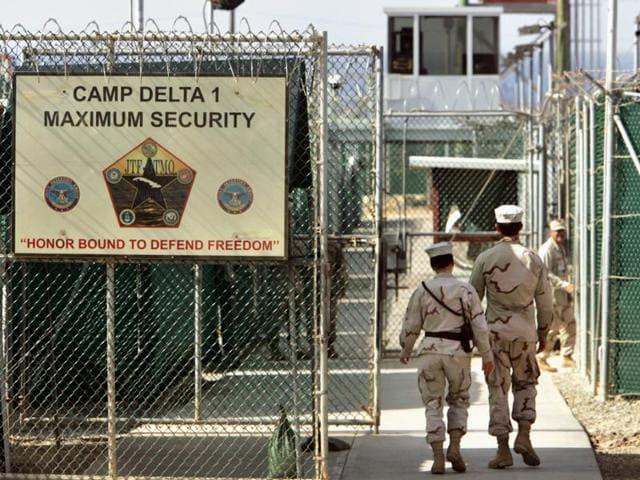 A File photo shows US military guards walk within Camp Delta military-run prison, at the Guantanamo Bay.(AP)