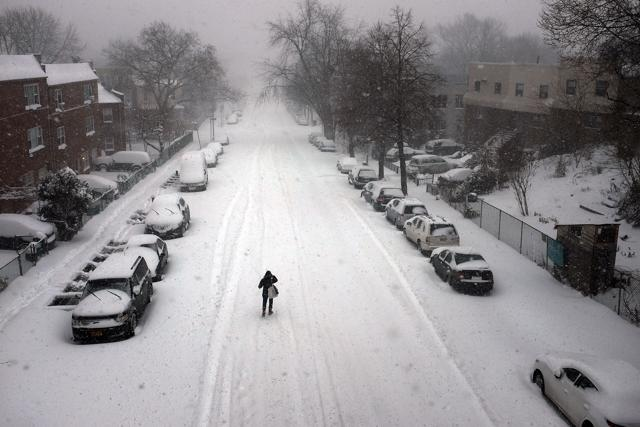 A woman walks in blizzard-like conditions in the Brooklyn borough of New York City.