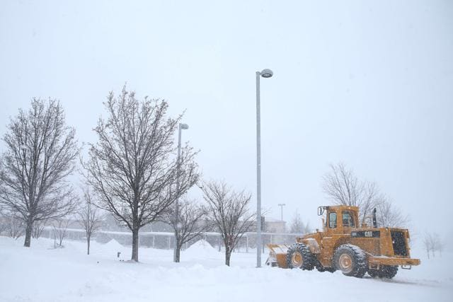 A large plow sits at Forest Lakes Elementary School on January 23, 2016 in Forest Hill, United States. Heavy snow continued to fall in the the Mid-Atlantic region causing blizzard conditions and affecting millions of people.